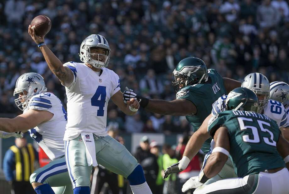 PHILADELPHIA, PA - JANUARY 1: Dak Prescott #4 of the Dallas Cowboys throws a pass in the first quarter against Fletcher Cox #91 of the Philadelphia Eagles at Lincoln Financial Field on January 1, 2017 in Philadelphia, Pennsylvania. (Photo by Mitchell Leff/Getty Images) Photo: Mitchell Leff, Getty Images