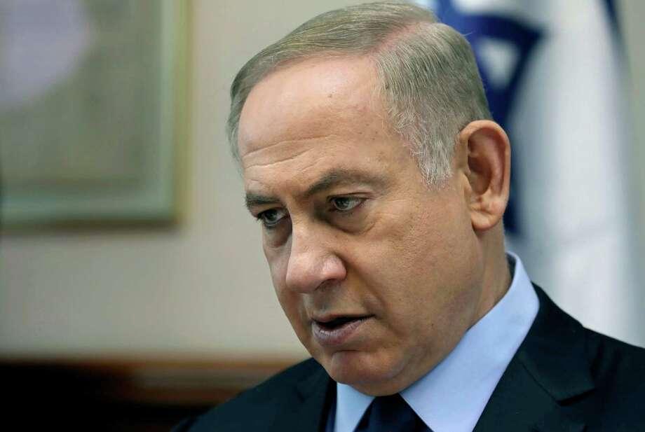 Israeli Prime Minister Benjamin Netanyahu chairs a weekly cabinet meeting, in Jerusalem, Sunday, Jan. 1, 2017. (Gali Tibbon/Pool photo via AP) Photo: Gali Tibbon, POOL / AFP or licensors