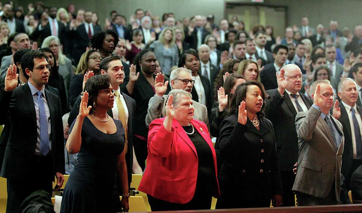Staff members are sworn in by Harris County District Attorney Kim Ogg during her inauguration Monday.