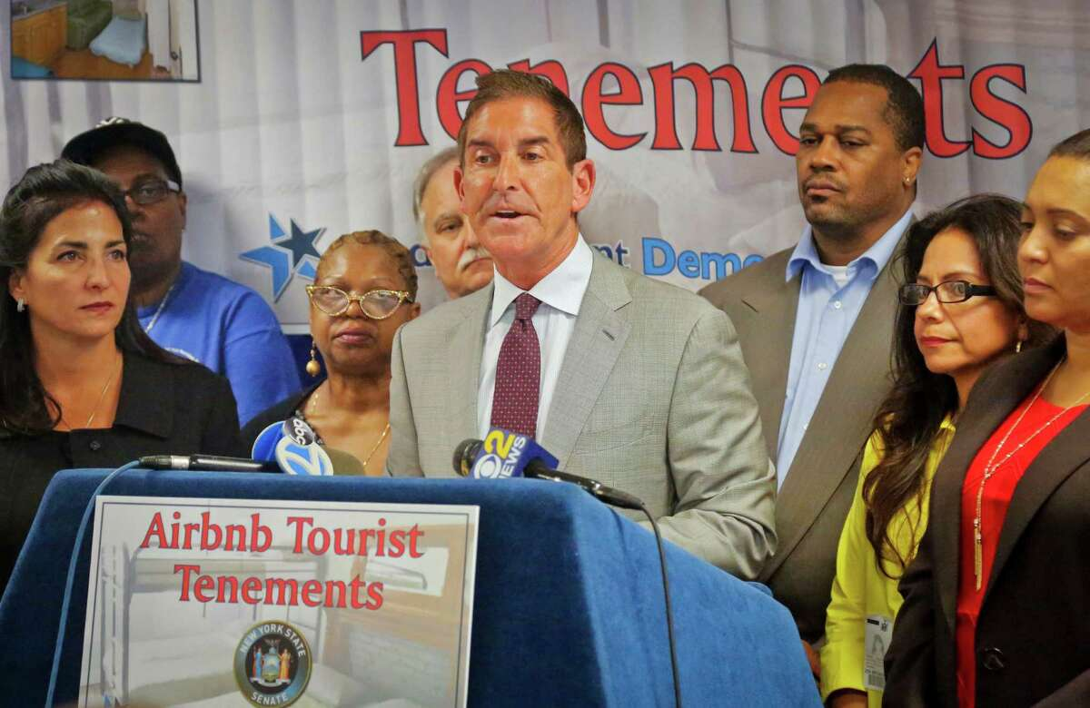 FILE - In this Sept. 26, 2016, file photo, State Senators Jeff Klein, center, and Diane Savino, left, are joined by local residents during a news conference to announce a legislative housing code proposal for Airbnb in New York. A new law that carries fines of up to $7,500 for certain kinds of short-term listings is causing headaches for many Airbnb hosts, who say they are getting unfairly swept up in a measure that's more aimed mostly at commercial operators who turn multiple apartments into, essentially, illegal hotels. (AP Photo/Bebeto Matthews, File) ORG XMIT: NYBM101