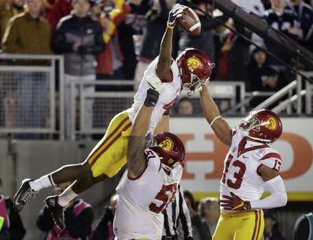Southern Cal running back Ronald Jones, left, was one of many offensive players who stood out Monday in the highest-scoring Rose Bowl. Photo: Jae C. Hong, STF / Copyright 2017 The Associated Press. All rights reserved.