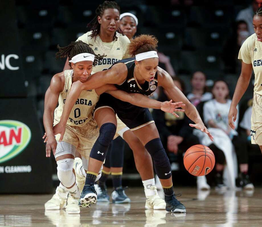 Manvel product Brianna Turner, right, holds off a steal attempt by Georgia Tech's Imani Tilford during a 55-38 Notre Dame victory in which Turner had nine points and 11 rebounds. Photo: John Bazemore, STF / Copyright 2017 The Associated Press. All rights reserved.