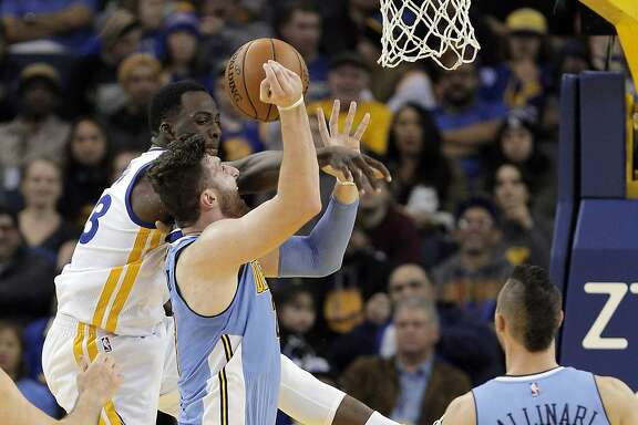 Draymond Green (23) leaps up to block a shot by Jusuf Nurkic (23) but fouled him in the first half as the Golden State Warriors played the Denver Nuggets at Oracle Arena in Oakland, Calif., on Monday, January 2, 2017.