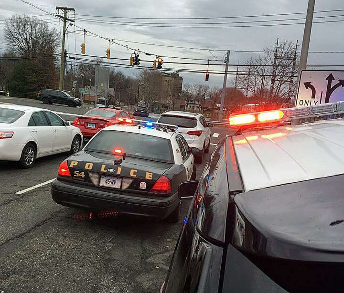 Norwalk police on the scene after the driver of a stolen car was stopped in Westport on Monday, Jan. 2, 2017. Police say a running car was stolen by two juveniles on Woodward Avenue at 8:53 a.m.