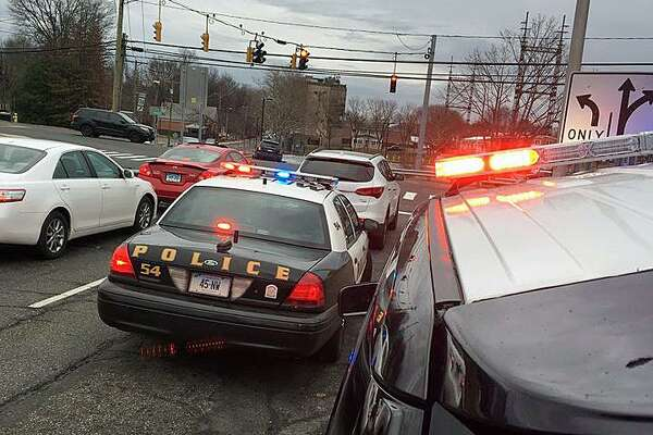 "Norwalk police on the scene after the driver of a stolen car was stopped in Westport on Monday, Jan. 2, 2017. Police say a running car was stolen by two juveniles on Woodward Avenue at 8:53 a.m. ""We remind everyone, don't leave your vehicle unlocked and running. It takes seconds for a criminal to enter the vehicle and drive away. Fortunately in this mornings incident the vehicle was recovered and no one was injured,"" police posted on their Facebook page."