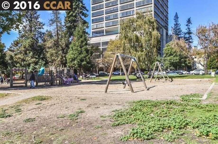 This Lake Merritt 1-BR, 2-BA offers close access to lake, and nice outdoor space. Price: $828K. Photos: MLS