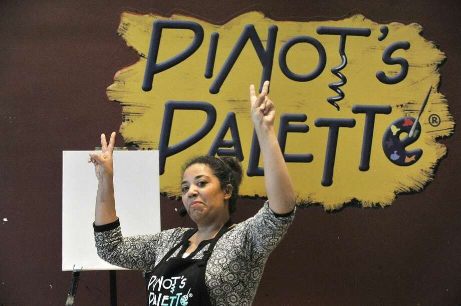 FILE — Artist instructor Christa Forrest starts off the painting session for a group at Pinot's Palette in Stamford, Conn., on Wednesday, March 11, 2015. Photo: Jason Rearick / Jason Rearick / Stamford Advocate