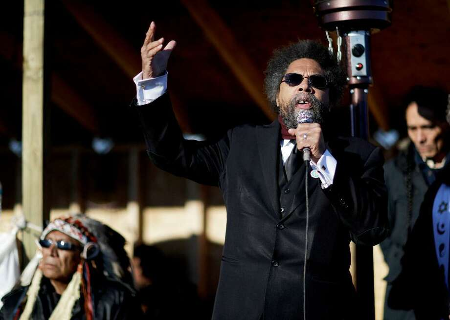 Cornel West, right, speaks next to Chief Arvol Looking Horse, a spiritual leader of the Great Sioux Nation, during an interfaith ceremony at the Oceti Sakowin camp where people have gathered to protest the Dakota Access oil pipeline in Cannon Ball, N.D., Sunday, Dec. 4, 2016. Photo: David Goldman /Associated Press