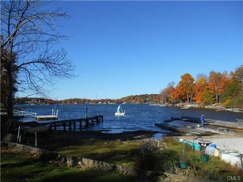 28 Shore Rd, Danbury, CT 06811  Auction  Foreclosure estimate  4 beds 4 baths 2,611 sqft  Features: Located on Candlewood Lake, waterfront views, additional .25 acre lot View full listing on Zillow Photo: Zillow