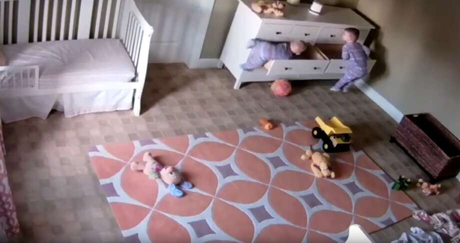 A Jan. 2, 2017 YouTube video shows a dresser collapse on a 2-year-old as his twin brother works to free him. Photo: Courtesy/YouTube Screengrab