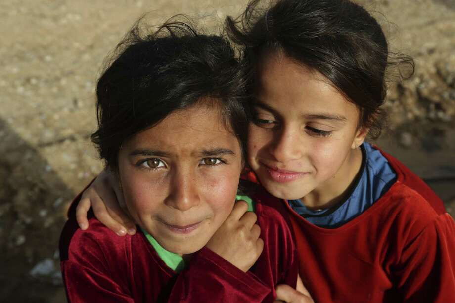 Displaced Iraqi children have their picture taken while gathering for a New Year's celebration at a camp east of Mosul. Photo: Khalid Mohammed /Associated Press / Copyright 2016 The Associated Press. All rights reserved.