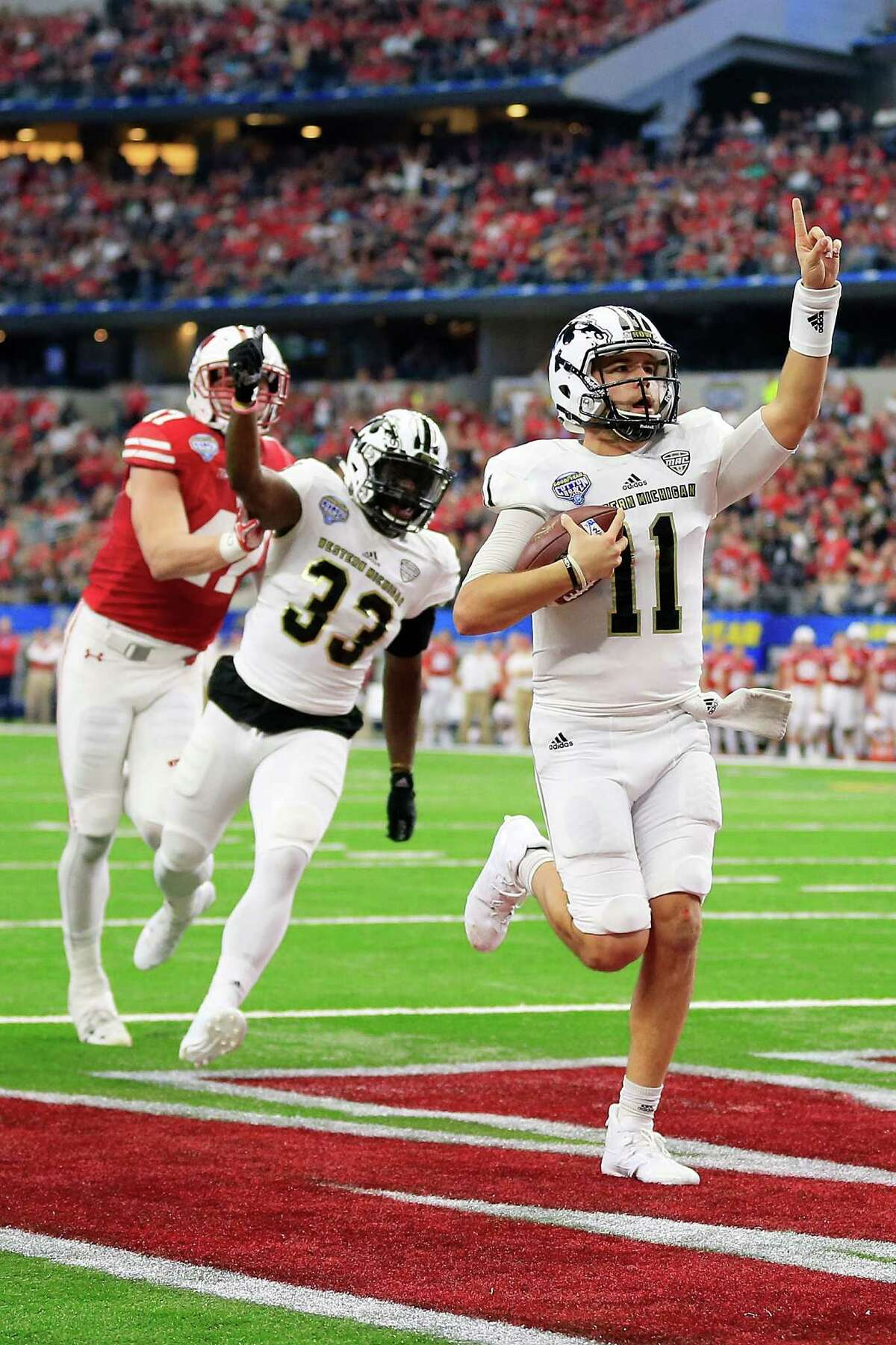 Mid-American Conference (0-6) Biggest 'win': Western Michigan faced a massive uphill climb in the trenches against Big Ten foe Wisconsin. Despite spotting the Badgers an early 14-point lead, the Broncos held their own in a 24-16 loss in the Cotton Bowl. The Broncos (13-1) had a chance to complete an undefeated season three years after winning one game. Biggest dud: In a 55-10 Miami Beach Bowl loss to Tulsa, Central Michigan gave up nearly 600 yards of total offense.