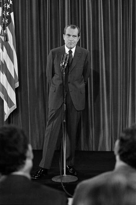 """FILE — President Richard Nixon at a news conference at the White House in Washington, Dec. 10, 1970. Nixon told an aide that they should find a way to secretly """"monkey wrench"""" peace talks in Vietnam in the waning days of the 1968 campaign for fear that progress toward ending the war would hurt his chances for the presidency, according to newly discovered notes. (Mike Lien/The New York Times) Photo: MIKE LIEN, STF / NYT / NYTNS"""