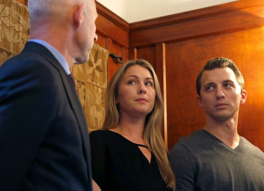 Denise Huskins and Aaron Quinn appear at a news conference with attorney Doug Rappaport (left) in San Francisco, Calif. on Thursday, Sept. 29, 2016. Huskins and Quinn were victims in the bizarre Vallejo kidnapping case in March 2015. Matthew Muller has pleaded guilty to kidnapping the couple. Photo: Paul Chinn / The Chronicle / /