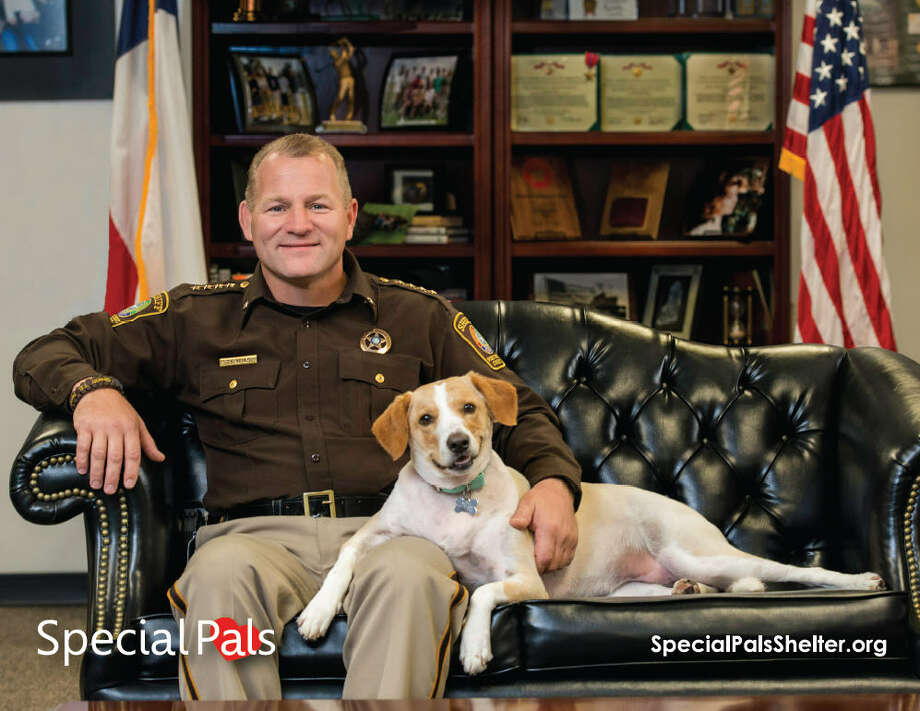 The Special Pals calendar for May features Fort Bend County Sheriff Troy E. Nehls and Archer. Photo: Sandy Flint