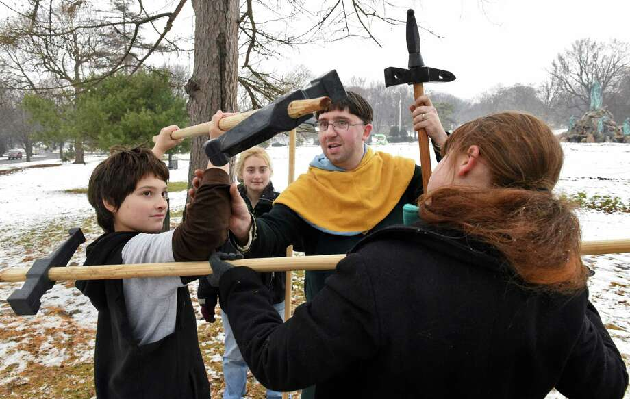 Historical martial arts instructor Ian Mumpton, center, of Albany, takes advantage of today's mild weather to hold a medieval polleax class for the Zorbas family of Albany, John, left,11, Callista,16, and Demetra,right, 13, outside in Washington Park Tuesday Jan. 3, 2017 in Albany, NY.  (John Carl D'Annibale / Times Union) Photo: John Carl D'Annibale