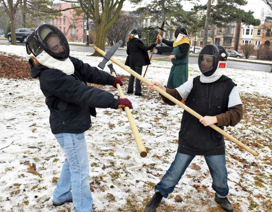 Callista Zorbas,16, left, of Albany blocks a polleax strike from her brother John, 11, during their class with historical martial arts instructor Ian Mumpton in Washington Park Tuesday Jan. 3, 2017 in Albany, NY.  (John Carl D'Annibale / Times Union) Photo: John Carl D'Annibale