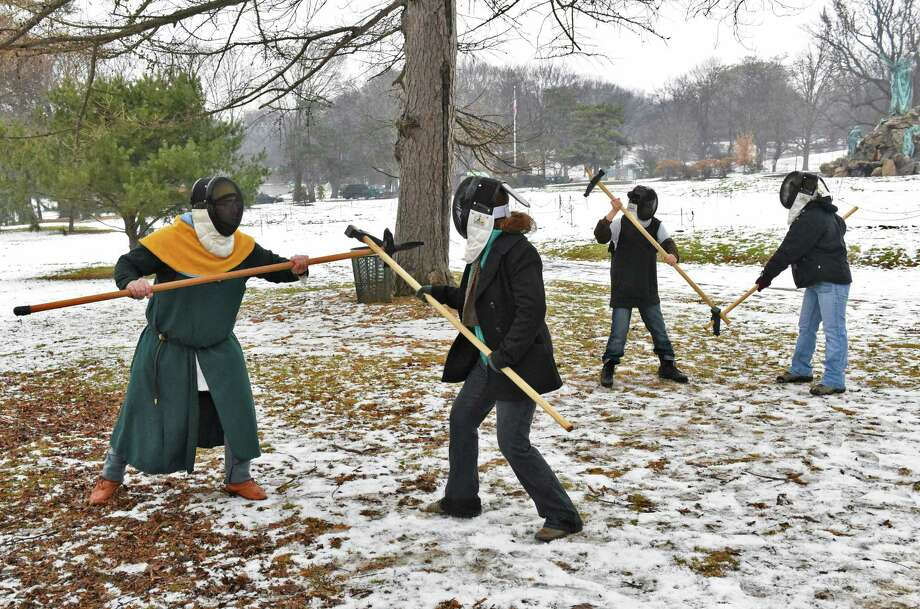 Historical martial arts instructor Ian Mumpton, left, of Albany, takes advantage of today's mild weather to hold a medieval polleax class for the Zorbas family of Albany, Demetra, center,13, John,11, and Callista,16, right, outside in Washington Park Tuesday Jan. 3, 2017 in Albany, NY.  (John Carl D'Annibale / Times Union) Photo: John Carl D'Annibale