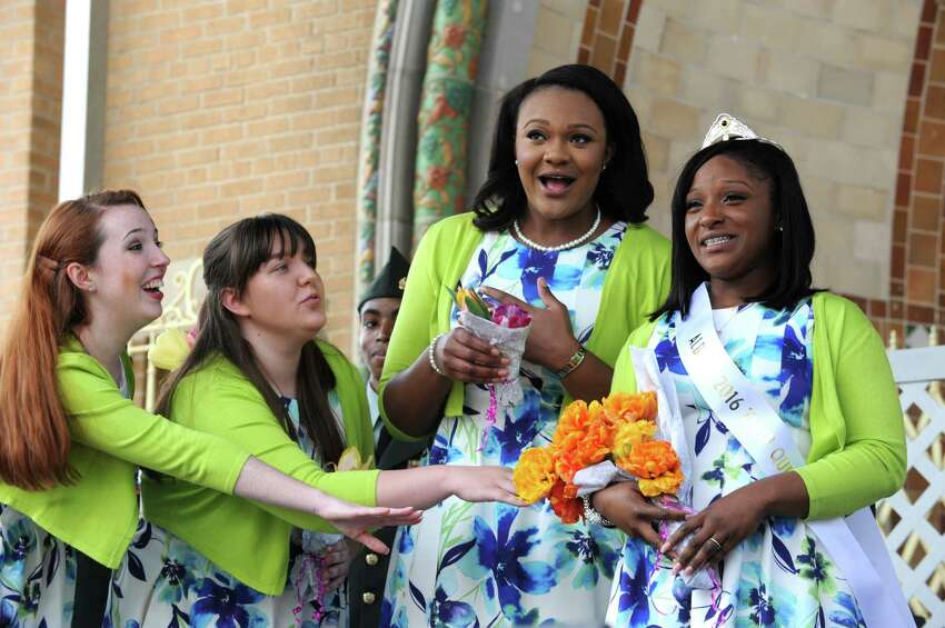 Newly crowned 2016 Tulip Queen Adaviah Ward of Albany,right, is congratulated by members of her court during the 2016 Tulip Festival in Washington Park on Saturday May 7, 2016 in Albany , N.Y. (Michael P. Farrell/Times Union)