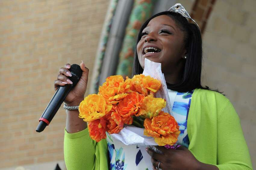 Newly crowned 2016 Tulip Queen Adaviah Ward of Albany speaks after her corination during the 2016 Tulip Festival in Washington Park on Saturday May 7, 2016 in Albany , N.Y. (Michael P. Farrell/Times Union)