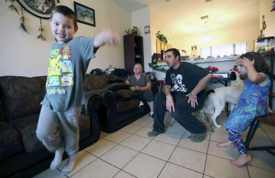 Robert Graves, left, his parents Tanya and Peter Graves, and his sister, Alexia, are seen Tuesday, DEc. 13, 2016 in their Schertz home. Photo: William Luther, Staff / San Antonio Express-News / © 2016 San Antonio Express-News