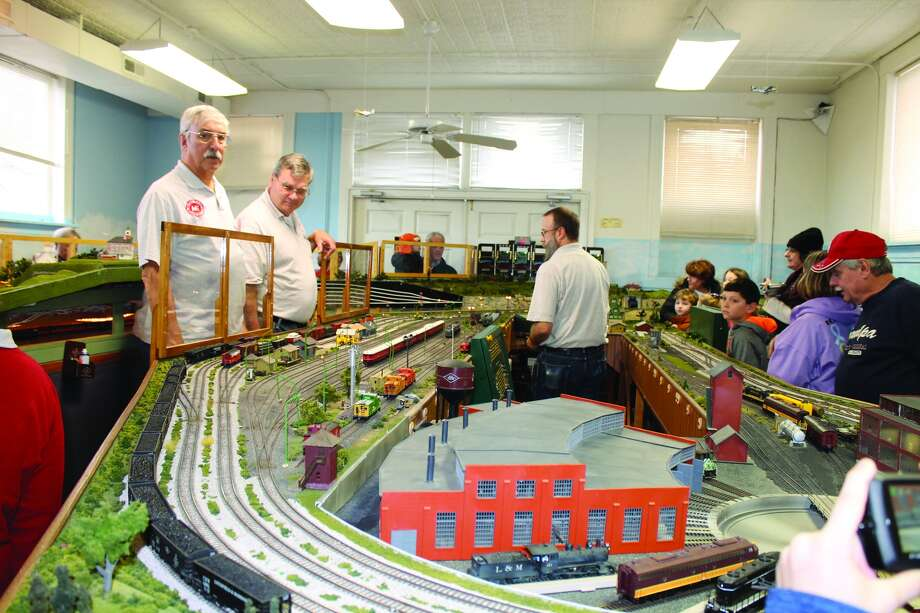 Members of the Metro East Model Railroad Club, in gray shirts, run trains around their layout during an open house Saturday at their facility inside the old Glen Carbon Firehouse/Village Hall on Summit Street. The club conducted three open houses during the holiday season – with Dec. 17's shortened by icy conditions. The HO scale layout will be on display again at an undetermined date in March. The open houses are free to the public. Photo: Bill Tucker • Intelligencer