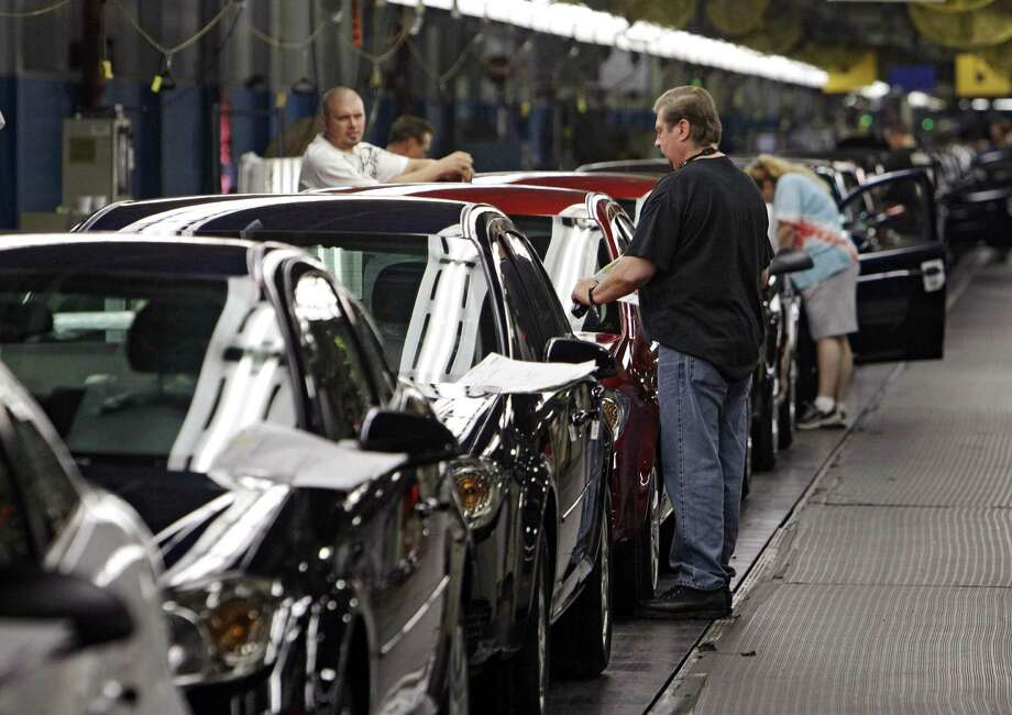 Workers assemble cars at General Motors' plant in Lordstown, Ohio. President-elect Donald Trump in a tweet Tuesday threatened to slap a tax on General Motors for importing its Chevrolet Cruze small cars to the U.S. from Mexico. But GM imports only a small percentage of its Cruzes from Mexico, with the vast majority made at Lordstown. Photo: Associated Press /File Photo / AP