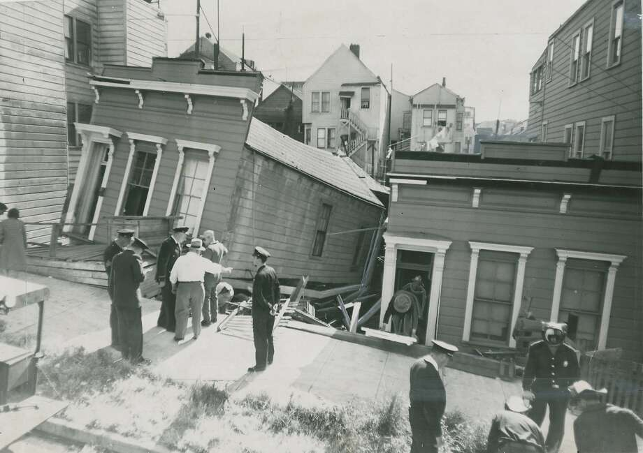June 21, 1961: A house at 262 Pennsylvania Street, in San Francisco's Potrero Hill District,  slid down and hit the house at 260 Pennsylvania Street. No one was injured. An old woman was briefly trapped inside her house next door. A third house sustained minor damage. All three were owned by the same person, who knew that the house was not safe. He had the tenants sign a waiver of responsibility. The house was built in 1906, and had been move to that location. None of the structures stand today. Photo: Bob Campbell, San Francisco Chronicle