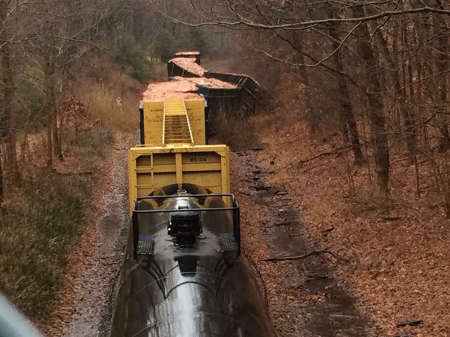 A Housatonic railroad line freight train carrying lumber and construction debris derailed near Silvermine Road in Brookfield at about noon on Tuesday. Photo: Carol Kaliff /The News-Times