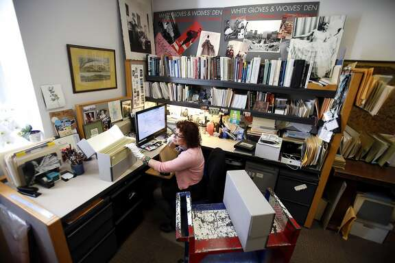 Christina Moretta sorts through photos to archive at the San Francisco Public Library where she works as photo curator in the San Francisco History Center December 6, 2016.