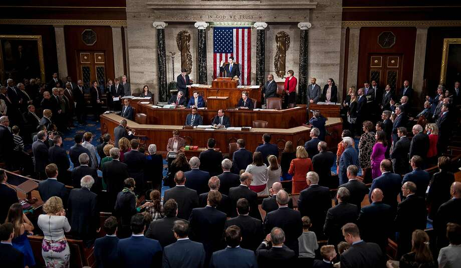 Speaker of the House Paul Ryan (C), R-Wisconsin, swears in the newly elected members of the House of Representatives during the opening of the 115th US Congress on Capitol Hill in Washington, DC, January 3, 2017.  Photo: JIM WATSON, AFP/Getty Images