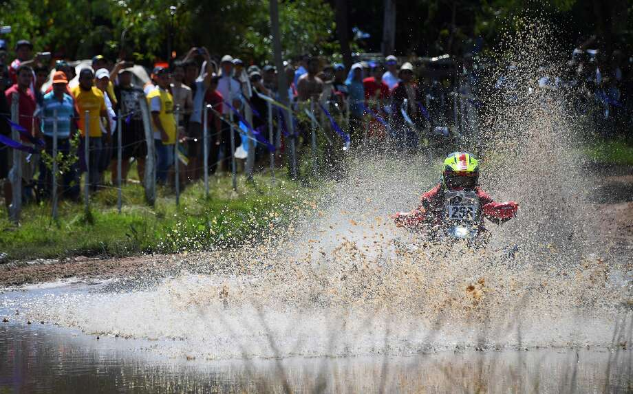 Argentine Daniel Domaszewski powers his Honda quad during the 2017 Dakar Rally Stage 1 between Asuncion and Resistencia, in Argentina, on January 2, 2017. / AFP / FRANCK FIFE        (Photo credit should read FRANCK FIFE/AFP/Getty Images) Photo: FRANCK FIFE/AFP/Getty Images