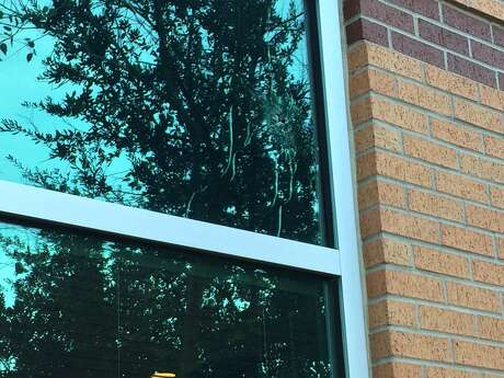 A window near the North Cypress Medical Center emergency room apparently was struck by a bullet during a police confrontation with an armed patient Tuesday morning, Jan. 3, 2017. (Andrew Kragie / Houston Chronicle)
