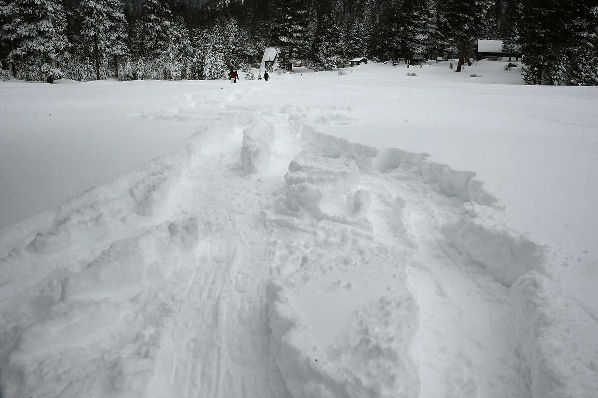 Tracks left behind after the California's Department of Water Resources conducted a snow survey at Phillips Station, California, on Tuesday January 3, 2017. Frank Gehrke the chief of cooperative snow surveys reported that the samples taken revealed that the snowpack is at 53% of average for this time of year at this location.