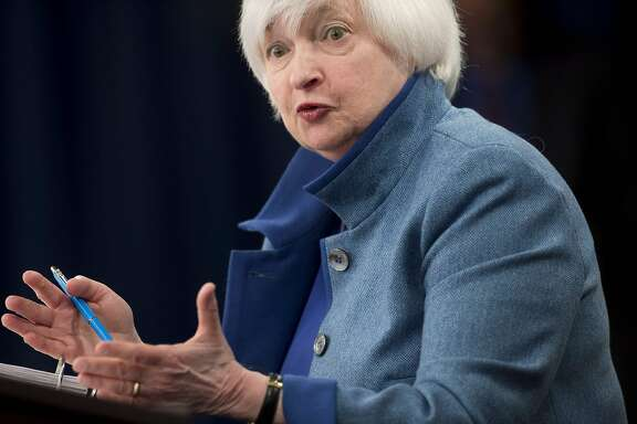 (FILES) This file photo taken on December 14, 2016 shows Federal Reserve Chair Janet Yellen  during a press conference following the announcement that the Fed will raise interest rates, in Washington, DC. The US job market is at its strongest since the start of the financial crisis and there are signs workers will start to see the benefits in their paychecks, Federal Reserve Chair Janet Yellen said on December 19, 2016. In the first speech by a Fed official since the central bank raised interest rates last week for only the second time in a decade, Yellen was moderately optimistic about job prospects, even though the economy is growing slowly.  / AFP PHOTO / SAUL LOEBSAUL LOEB/AFP/Getty Images