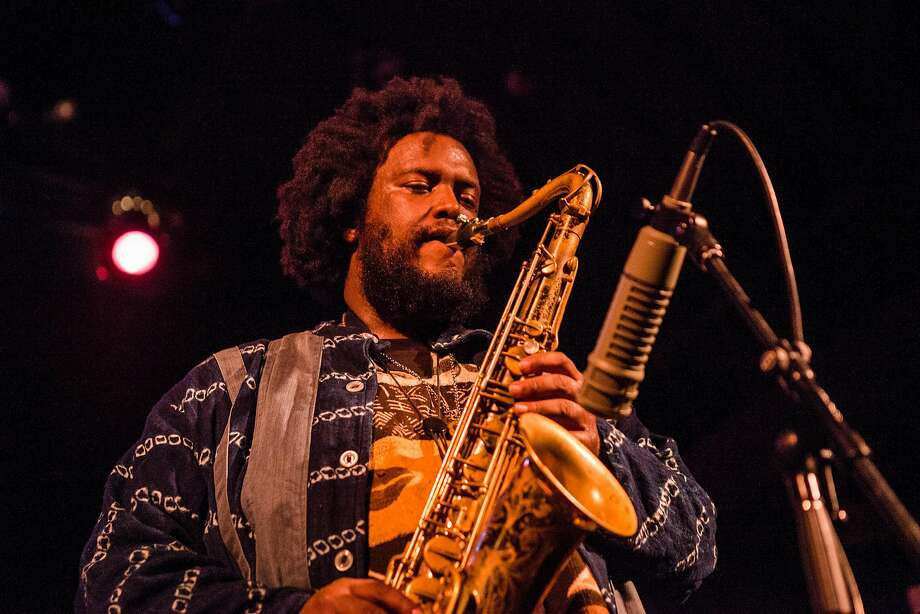 -- FILE -- Kamasi Washington plays at the Bearsville Theater, in Woodstock, N.Y., Aug. 19, 2015. The musician likes to keep an open mind about the state of jazz and its freedom. (Lauren Lancaster/The New York Times) Photo: LAUREN LANCASTER, NYT