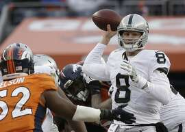 Oakland Raiders quarterback Connor Cook passes against the Denver Broncos in the first half of an NFL football game, Sunday, Jan. 1, 2017, in Denver. (AP Photo/Jack Dempsey)