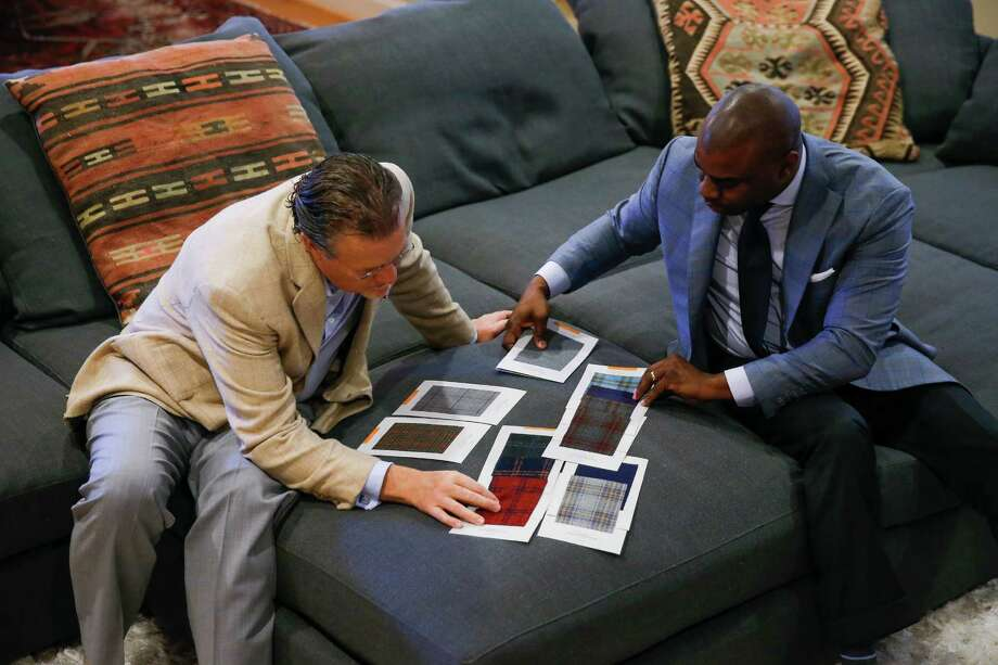 Established Bespoke owner Gary Warfield, right, and client Kevin Jones look at fabric samples for Jones' wardrobe.  Photo: Michael Ciaglo, Staff / © 2016  Houston Chronicle