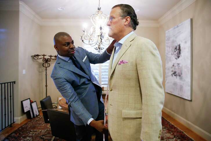 Established Bespoke owner Gary Warfield takes measurements of client Kevin Jones at his home Saturday, Dec. 31, 2016 in Houston. Warfield's company makes house calls to fit clients clothes. ( Michael Ciaglo / Houston Chronicle )