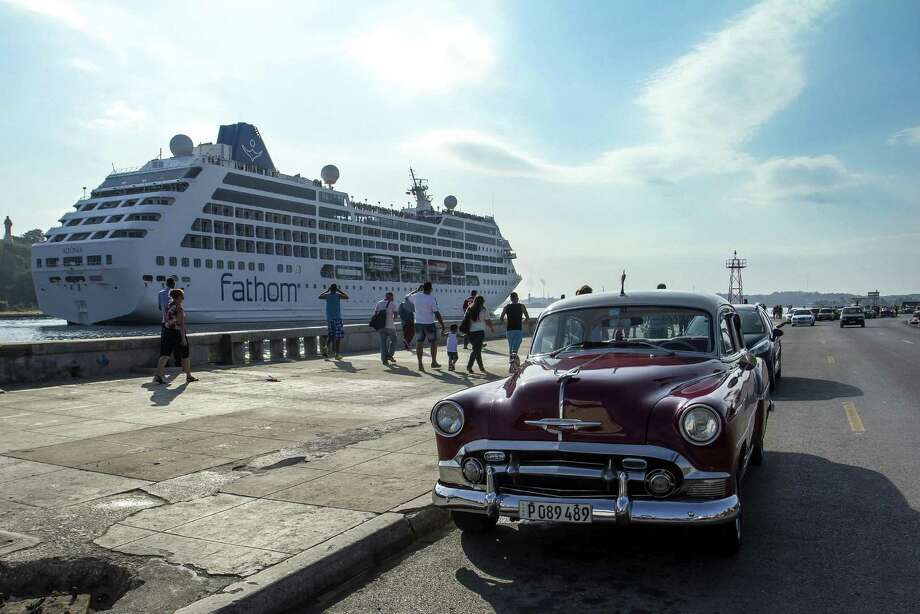 Vintage American cars in Havana serving as taxis await possible fares disembarking the 704-passenger Fathom Adonia. Photo: Courtesy, Carnival Cruises