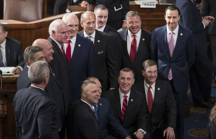 Republican members of the House of Representatives gather for a photo in the House Chamber on Capitol Hill in Washington, Tuesday, Jan. 3, 2017, as the 115th Congress convened. (AP Photo/J. Scott Applewhite)