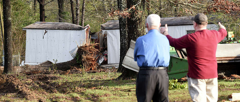 Patrick Davenport, left, and neighbor J.P. Kelley view the scene of Monday's tornado that claimed the lives of multiple people near Rehobeth, Ala. and eased drought conditions across the Southeast. Photo: Danny Tindell, MBO / Dothan Eagle