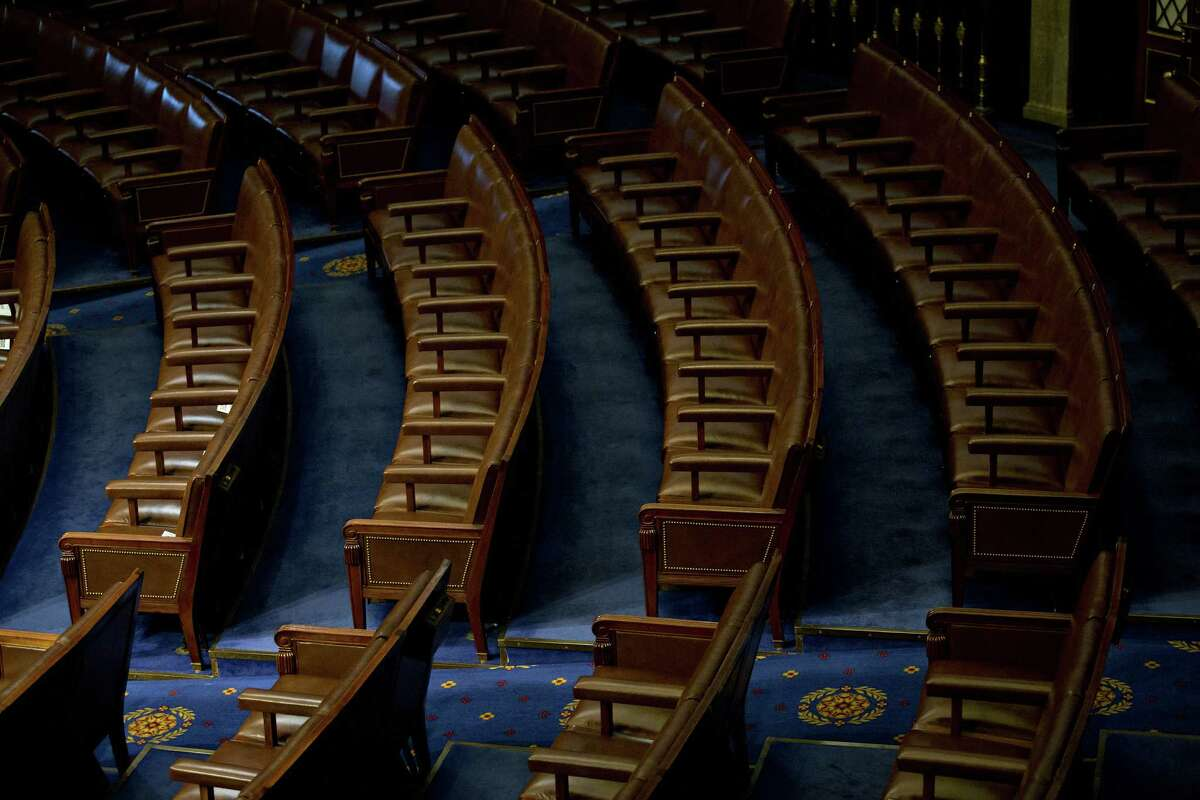 Chairs sit empty in the House Chamber at the U.S. Capitol in Washington, D.C., U.S., on Tuesday. Members of Congress reversed an effort to weaken the Office of Congressional Ethics, instead taking the face-saving tack of studying possible changes to the office. Photographer: Andrew Harrer/Bloomberg
