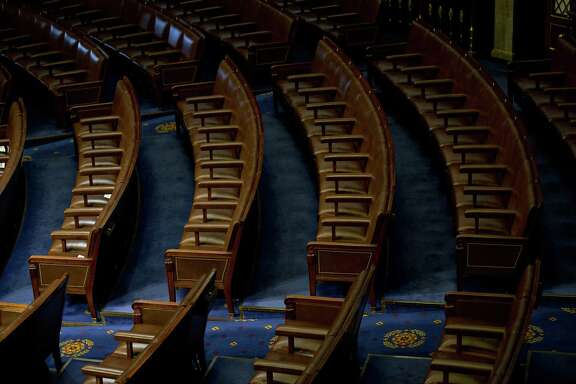 Chairs sit empty in the House Chamber at the U.S. Capitol in Washington, D.C., U.S., on Tuesday. Members of Congress reversed an effort to weaken the Office of Conressional Ethics, instead taking the face-saving tack of studying possible changes to the office.  Photographer: Andrew Harrer/Bloomberg