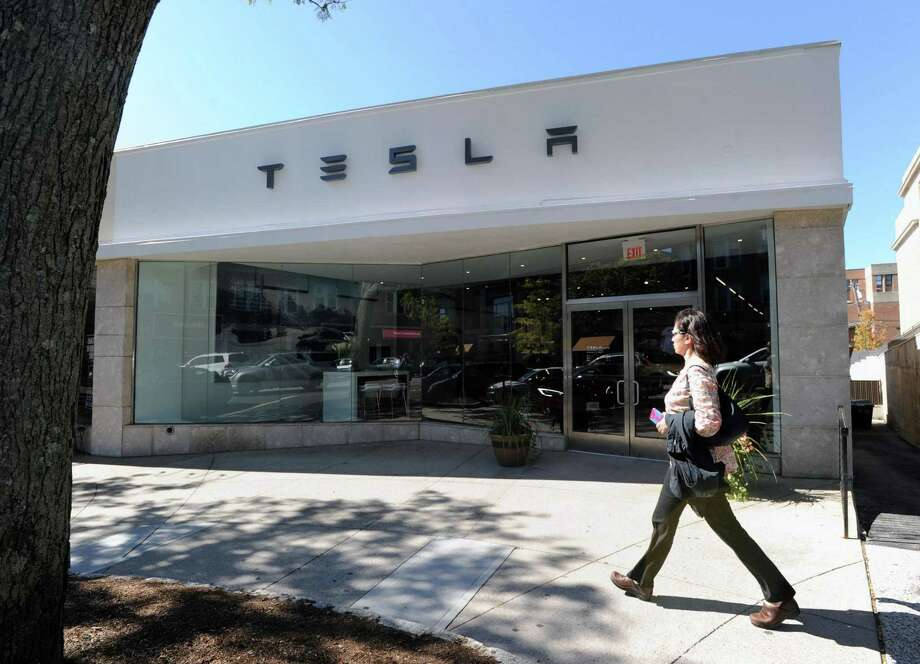 The official first day of business at the Tesla store located at 340 Greenwich Ave., Greenwich, Conn., Friday, Oct. 7, 2016. Tesla designs and manufactures premium electric vehicles. Photo: Bob Luckey Jr. / Hearst Connecticut Media / Greenwich Time