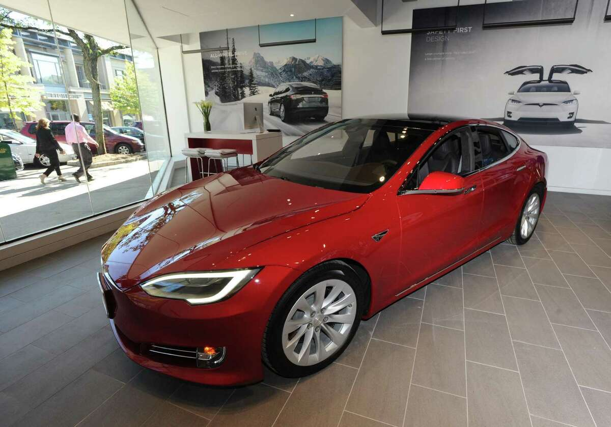 The official first day of business at the Tesla store located at 340 Greenwich Ave., Greenwich, Conn., Friday, Oct. 7, 2016. Tesla designs and manufactures premium electric vehicles.