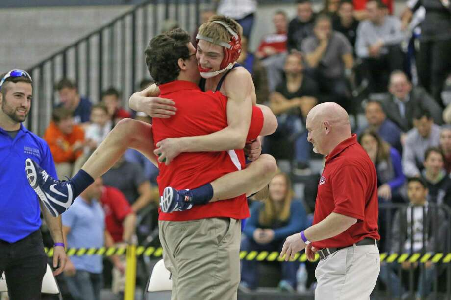 New Fairfield High School's Alec Opsal celebrates with coach after his 120 lb weight class win during Saturday's State Open wrestling championships at Flyod Little Athletic Center in New Haven. Photo: Mike Ross / For Hearst Connecticut Media / Connecticut Post Freelance