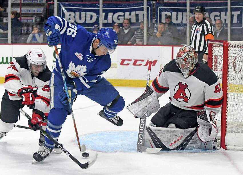 Devils defenseman Brandon Gormley defends against Marlies Kerby Rychel in the crease during their hockey game at the Times Union Center on Tuesday Nov. 22, 2016 in Albany, N.Y. (Michael P. Farrell/Times Union) ORG XMIT: MER2016112220341066