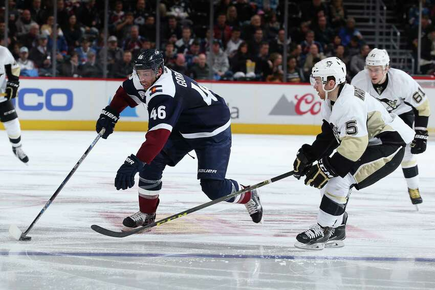 DENVER, CO - DECEMBER 09: Brandon Gormley #46 of the Colorado Avalanche brings the puck across the blue line against David Warsofsky #5 of the Pittsburgh Penguins at Pepsi Center on December 9, 2015 in Denver, Colorado. (Photo by Doug Pensinger/Getty Images) ORG XMIT: 574713089 ORG XMIT: MER2017010317243402