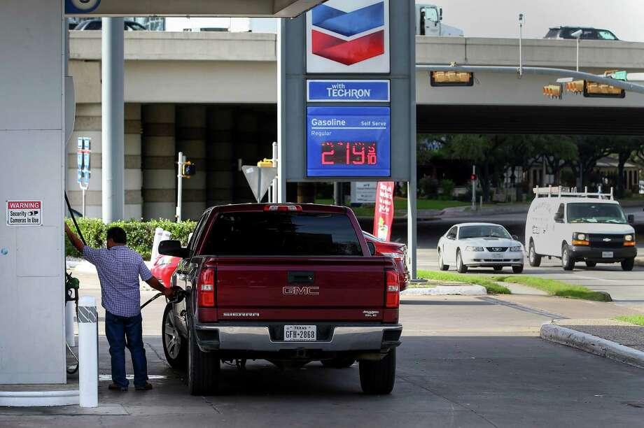 A man pumps gas at a Galleria-area gas station, Tuesday, Jan. 3, 2017, in Houston. Photo: Jon Shapley, Houston Chronicle / © 2015  Houston Chronicle